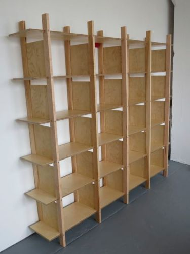 Shelves made of Amercian birch plywood, maple supports, and plywood dividers.